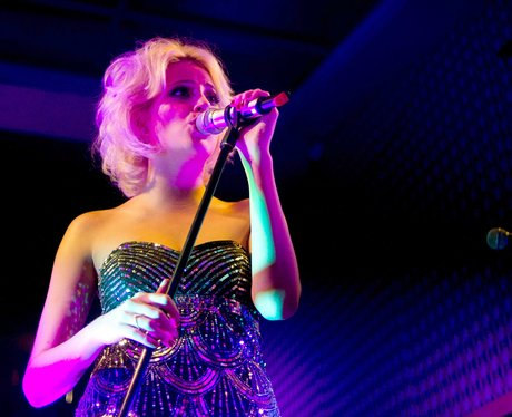 Pixie Lott with stage lighting